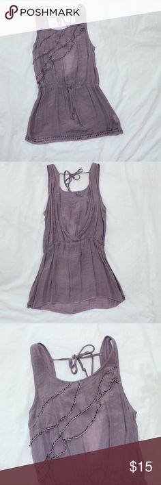 Purple dainty blouse This top is very light and airy. perfect for the spring and summer. It's in great used condition. It is missing a few of the beads as pictured above(last photo). It's only missing a few. Not noticeable. Other than that no holes or stains. MEASURMENTS: Bust is 12.5 inches, waist is 12 inch Length is 27 inches. Check out my closet. Pretty Good Tops Blouses