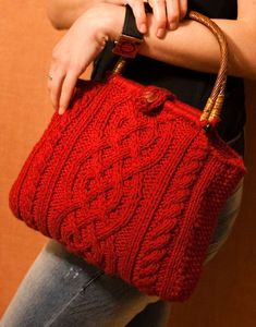 Free Knitting Pattern for Viking Cable Handbag - This purse features 3 cable patterns. Designed by Karen S. Lauger who says it is a good first cable project.Pictured projectbyathreena who added side gussets and a button flap. Available in English and Danish.