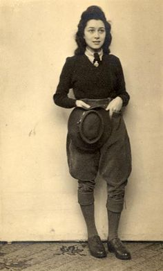 Women's Land Army Uniform: brown brogues, wool socks, brown corduroy breeches, fawn shirt, green v-neck wool jumper, green tie and felt hat