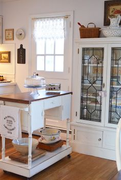 A Cottage Style Kitchen - love the modern leadlight cupboard and the island bench on castors x