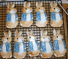 "Bunny Cookies - These are a few cookies I made for a baby shower with a ""Peter Rabbit"" theme.  I used Penny's recipe for the cookie and Antonia74's for the icing, then hand painted the shading and details with a tiny paintbrush and watered down food coloring."
