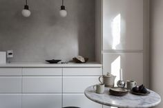 Minimalist kitchen with greige walls, white cabinents and bulb pendant lights Scandinavian Kitchen, Scandinavian Interior, Kitchen Interior, Kitchen Design, Kitchen Ideas, Paint My Room, Trending Paint Colors, Interior Decorating, Interior Design