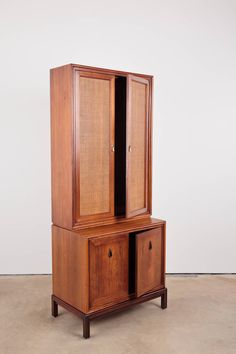 Mid Century Modern Walnut and Rosewood Cabinet | From a unique collection of antique and modern cabinets at https://www.1stdibs.com/furniture/storage-case-pieces/cabinets/