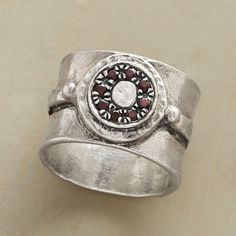 """GARNET MANDALA RING--In this sterling silver and garnet mandala ring, an ancient symbol of the universe is sparked with garnets atop a hammered, handcast sterling silver band. Exclusive. Whole sizes 5 to 9. 1/2""""W."""