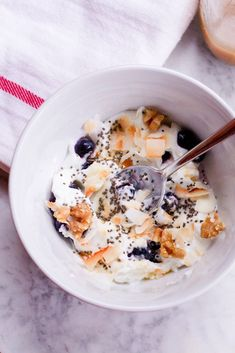 Yogurt Breakfast Bowl with Toasted Coconut, Walnuts, Blueberries and Chia Seeds -- 26 grams of protein in one bowl!