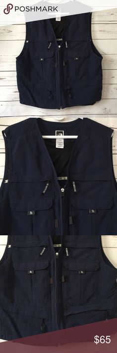 The North Face utility vest Waterproof utility vest! Tons of pockets! Light weight. Mint condition. Says large, fits like a men's medium. The North Face Jackets & Coats Vests
