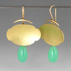 A pair of earrings with an 18k yellow gold hammered scalloped element, and smooth chrysoprase teardrops, on gold hooks.