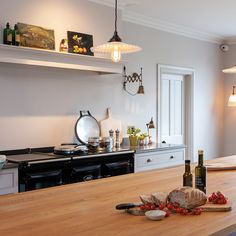 Beautiful Kitchen Design We love this stunning kitchen featuring a black AGA range cooker Aga Kitchen, Handleless Kitchen, Kitchen Mantle, Kitchen Design, Aga Stove, Beautiful Kitchen Designs, Farmhouse Style Kitchen, British Country Kitchen, Range Cooker