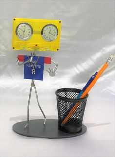 MC Rewind is a Hip Hop artist, that specializes in freestyle rap. He can spontaneously rap, and repeat random verses of his rhymes, backwards. Freestyle Rap, Desk Clock, Hip Hop Artists, Repeat, Verses, Table Lamp, Canning, Random, Home Decor