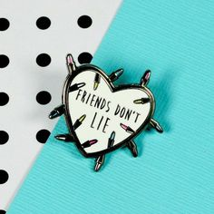 Friends Dont Lie Enamel Pin with butterfly clutch on the reverse. Teeny enough to adorn your bag, lapel, pocket or whatever you fancy. Hand designed here in the UK, and manufactured in exclusive low quantities. This pin measures 30mm high, and is made from lovely gunmetal hard enamel for a hard wearing finish.