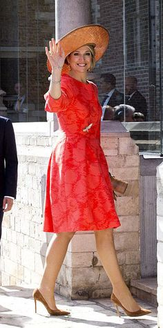 Queen Maxima looked summery in a bright orange dress coat, the national color of…