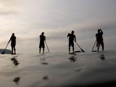 Paddle the waters of Wisconsin. Stand up paddleboarding.