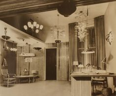 The Finland House showroom on Manhattan, New York, early 1950s, featuring a large collection of Paavo Tynell fixtures. Owned by the Finnish-American trading council, the Finland House got a major impact on Paavo Tynell´s success in America, selling exclusively his design in US. Picture from the book Paavo Tynell ja Taito Oy (PT Arkisto)