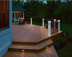 Deck with built in lighting, wraps around house. We need Eric to build us one of these!
