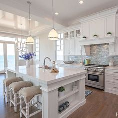 Do you like this #whitekitchen? Look at the cabinets, the backsplashes, and most importantly the view! Perfect! Isn't it? If you want to build a dream kitchen like this, you definitely should try our White Shaker cabinets. We recommend you order a sample door to see the quality! Trust me, you will love it.