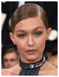 Steal Gigi Hadid's take on the glitter root trend.