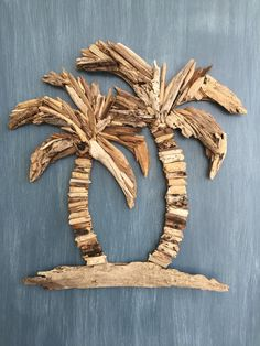 This beautiful driftwood palm tree wall decor is made of natural driftwood found on the beaches of South Florida. Each piece of driftwood is hand