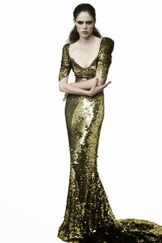 Coco Rocha in a long gold sequins gown