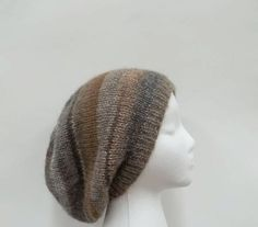 Knitted colorful slouchy hat wool blend - The colors of this beanie beret slouch hat are brown, gray, tan, beige, med brown, dark gray. Very stretchy, will fit any head, stretches out to 31 inches around. The yarn is 53% wool and 47% acrylic. Very soft.  Available at:  http://www.CaboDesigns.etsy.com