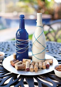 Wine and Cheese Party Ideas. These painted bottles covered in colorful twine are fantastic!