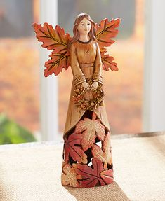 The Harvest Leaf Gift Collection, in glorious autumn colors, is an eye-catching way to decorate for the fall season.The leaf motif of the Harvest Leaf Gift Collection is especially appropriate for the season. Harvest Decorations, Centerpiece Decorations, Seasonal Decor, Fall Decor, Clay Angel, Ceramic Angels, Lakeside Collection, Orange Leaf, Angel Statues