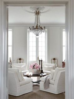 .4 matching chairs in living room, love this room with it's beautiful windows and chandelier, elegant Good Life of Design