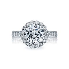 Tacori style no. HT2605RD95. A bloom of round diamonds blooms the 3.5 carat round center of this