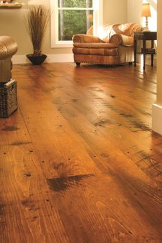 Those floors 😍😍Carlisle Wide Plank Floors Eastern Hit or Miss White Pine in a Traditional Living Room. The quality of a Carlisle floor is matched only by that of the customer experience.