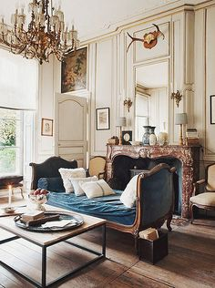 So much to love - faded blue velvet, trim on walls, modern elements in a traditional room