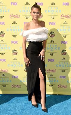 34e386ad37 Zendaya from 2015 Teen Choice Awards Red Carpet Arrivals The opts for a  sassy monochromatic Ashi Studio ensemble with ample silver accessories.
