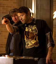Serious director Misha, wearing a Sam Winchester tee.