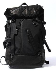 ShopStyle: [DECADE]60nylon×oiled cow leather backpack