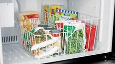 Freezer baskets are great for both upright and chest freezers to separate and categorize food {featured on Home Storage Solutions 101}