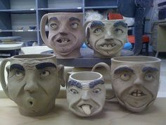 A Collection of leather hard clay face mugs. by fortbruce, via Flickr