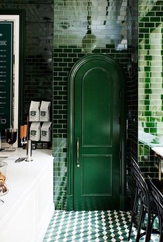 """Absolutely love these subway tiles, not to mention the door! """"Interiors of the new Ralphs Coffee shop in New York City. Hunter green tile walls, white tin ceilings, and marble-top counters create the…"""" Green Subway Tile, Green Tiles, Subway Tiles, New York City, Plafond Design, Most Popular Instagram, Shops, Marble Top, Hunter Green"""
