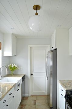 Kitchen remodel with walls painted in BM Gray Owl and cabinets, ceiling and trim painted in BM White Dove. | chatfieldcourt.com