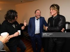 Commissioner Gary Bettman (C), Robby Takac (L) and Johnny Rzeznik of the Goo Goo Dolls share a laugh backstage at the 2018 Bridgestone NHL Winter Classic New Year's Eve Bash at Hammerstein Ballroom on December 31, 2017 in New York, New York.
