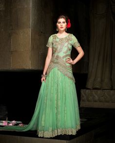 Light green floor length anarkali suit with golden embellished yoke   1. Light green net jacquard anarkali suit2. Golden thread sequins embroidered border on flare3. Comes with matching bottom and dupatta4. Can be stitched upto size 44 inches