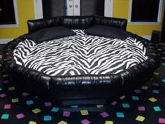 This is water bed, I do and I don't want one at the same time because i have a fear of it popping and me falling in and drowning in my sleep, i am kinda over dramatic soooo, yea lol Dream Rooms, Dream Bedroom, Zebra Print Bedding, Overstuffed Chairs, Round Beds, Dreams Beds, Water Bed, Chaise Sofa, Cool Beds