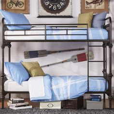 $580; Understated and versatile, this essential metal bunk bed makes the perfect addition to the kids room or guest suite ensemble. Top it with crisp bedding and plush pillows for cozy appeal.