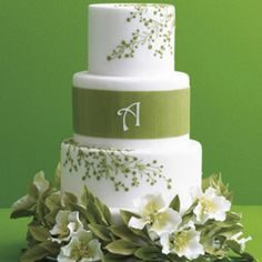 Green Leaf and Monogram Cake -- Lifelike sugar leaves and flowers make this confection a showstopper. Cake by Ana Parzych Custom Cakes