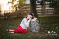Bonnie Hill Photography #bonniehillphotography #childrensportraiture Children's portraiture Her blue eyes are electrifying! Love the fence in the background.