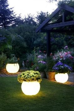 ...amazing idea  via Cathy Little. She painted flower pots in Rustoleum's Glow in the Dark paint for this awesome effect. They absorb the sunlight during the day and then glow in the evening! Who am I kidding? I'm still going to do this. It is just too cool..