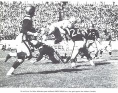 Oregon halfback Leroy Phelps dives vs. Idaho in Moscow, ID in 1957. From the 1958 Oregana (University of Oregon yearbook). www.CampusAttic.com