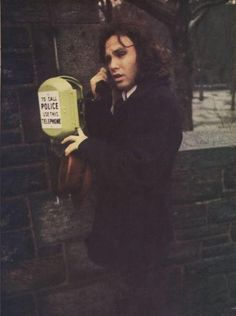 Jim Morrison trying to make us believe he's calling the POlice.