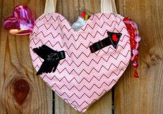 Heart Tote Tutorial. Make an adorable bag for Valentine's Day with this Heart Tote Tutorial. Your little girl can carry all her cards and candies in this easy sewing project. Add an applique arrow to make this canvas DIY tote bag even cuter!