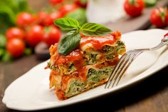 11969370 - delicious homemade lasagne with ricotta cheese and spinach on wooden table