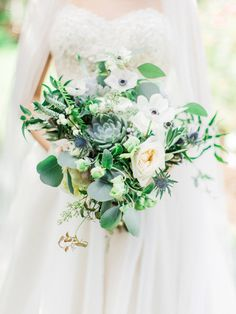 Anemone, dahlia, succulent, and thistle wedding bouquet: Photography : Elyse Hall Photography  Read More on SMP: http://www.stylemepretty.com/little-black-book-blog/2017/02/01/rustic-elegant-new-hampshire-wedding-inspired-by-seaglass/