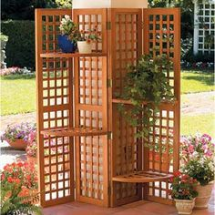 I'm pretty sure there are some old shutters in the shed... I could totally use this idea as a screen for the alley side of the porch.