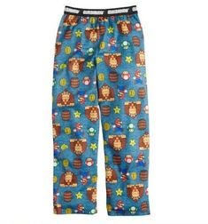 Pants are blue, are pull on with elastic waist and have MARIO and DONKEY KONG all over them. Pikachu Pajamas, Super Mario And Luigi, New Iron Man, Flannel Pajama Pants, Boy Character, Boys Pajamas, New Pokemon, Loose Pants, Pjs